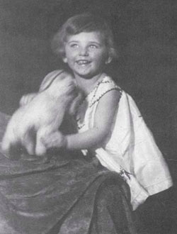 Eva Rappaport, founder of Kings Valley Collies in Oregon, as a child with stuffed dog, Flocky.